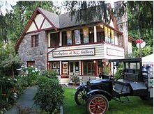 BC Gallery, a photo of an older victorian style home with an old milk truck parked out front.