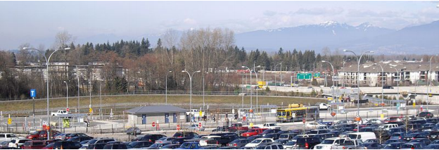 photo of Langley Bus Depo parking lot. Rows upon rows of parked vehicles.
